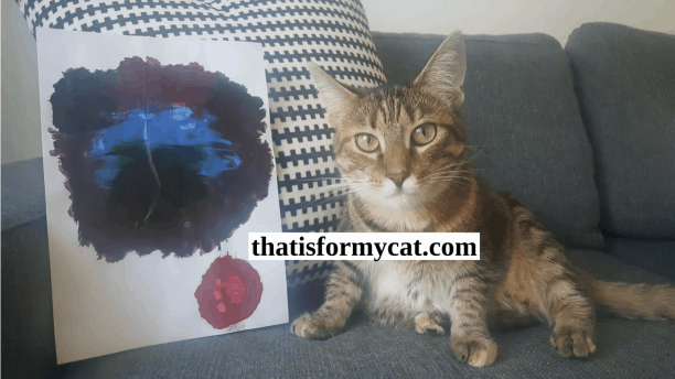 Cat with her artwork